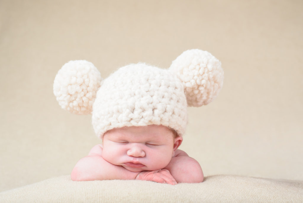 newborn portrait with cute hat